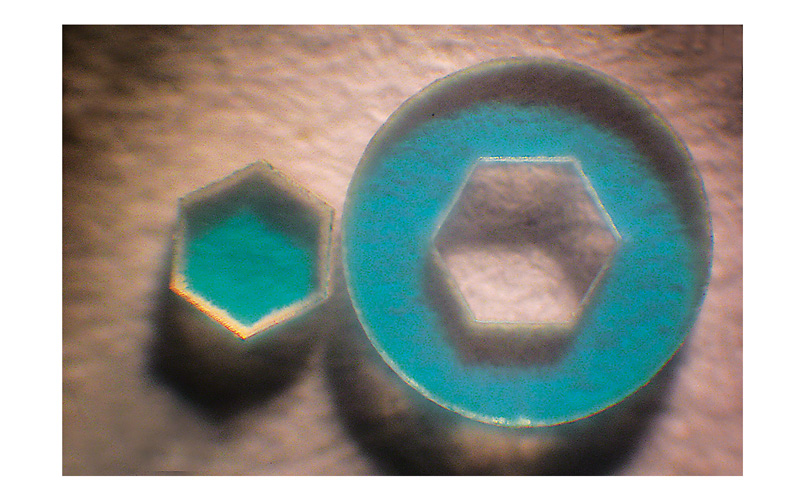 Round and hexagonal parts cut out from LCD filter glass with thickness of 0.3 mm using the Atlantic series lasers at 266 nm