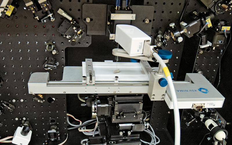 SFG spectrometer with Langmuir trough used for studies of the unique properties of molecules in monolayers